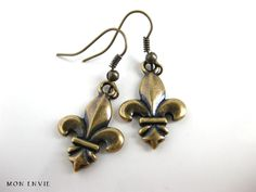 Antiqued Brass Metal FleurdeLis Dangle Earrings. $8.00, via Etsy.