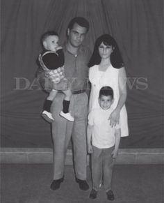 Photo from 1970 shows John Gotti holding his son Frankie Gotti and standing beside his wife Victoria Gotti with John (Junior) Gotti standing in front at Lewisburg Federal Penitentiary. Real Gangster, Mafia Gangster, Gangster Party, Carlo Gambino, Mob Wives, Mafia Families, John Junior, Al Capone, Social Club