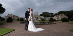 Syon park wedding photographer photography wide view of conservatory stunning light Suzanne Neville dress kiss