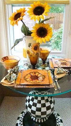 Pretty tablescape with sunflowers. Love the mackenzie-childs table base!