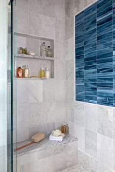 Dress up your bathroom with one of these inspiring shower tile designs. A variety of materials, colors, shapes, and layouts create unique shower tile ideas for a one-of-a-kind bathroom. #bathroomideas #bathroomtile #bathroomshowertiles #bhg