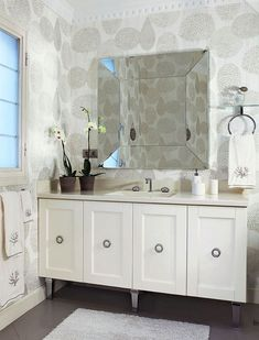love the vanity on chrome legs and wallpaper