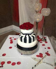 Red, Black, and White wedding cake. Made by Tannicakes at tanniboo@gmail.com #Tannicakes #weddingcake