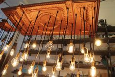Salvaged Ceiling Tin Repurposed into Chandelier Light Fixture with Industrial style pendants