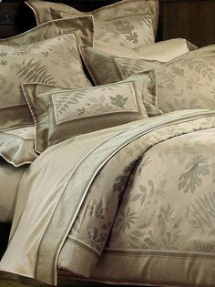 Featuring a beautiful nature motif. the Trentino Bedding Collection that's sure to inspire serenity in your master suite.