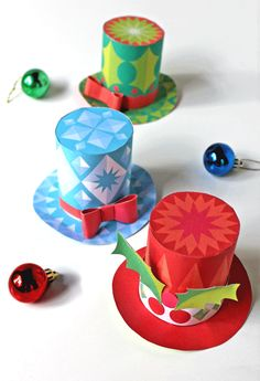 How to make 3 festive mini top hats using our easy no sew hat templates and our simple to follow step-by-step tutorial. Party hat pattern, party decorations, designs, easy step-by-step instructions and templates. Print as many as you like. https://happythought.co.uk/craft/printables/mini-top-hats/festive-paper-hats #minitophats #partyhatpattern #christmas