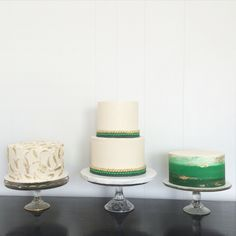 Emerald green, kelly green, cream, and gold cake trio! All buttercream cakes with fondant bead accents on the two tier. Left to right- orange coconut carrot cake with cheesecake filling frosted with rustic styled buttercream and gold highlights. Middle cake- chocolate/ganache and WSCA wedding cake, all buttercream with gold, and ombré green fondant bead accents. Right- lemon blueberry/lemon curd with green ombré and watercolor buttercream and gold strokes blended in.