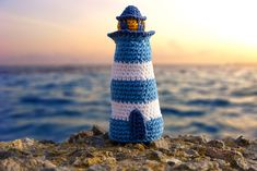Bring a sea moods to your home with our crochet pattern a lighthouse. You will need: Hook 2.5 White, blue, dark blue and orange cotton yarn Stitch marker Needle Inc – increase, dec – decrease, sc – single crochet, bpsc - back post single crochet Size of a lighthouse – 12 cm / 4.7 in When you are changing yarn color,