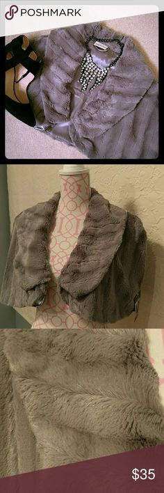 HOST PICK Reduced for the party NWT cape Perfect for the holidays and beyond. Faux fur in shades of gray. Total length is 14 inches. Fully lined. Jackets & Coats Capes
