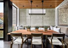 Contemporary Neutral Dining Room with Walnut Ceiling Panels Contemporary Neutral Dining Room, Contemporary Light Fixtures, Urban Interior Design, Leather Wingback Chair, Padded Wall, Iron Coffee Table, Ceiling Panels, Sofa Design, Interiors