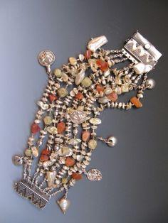 Bracelet....fresh water keshi pearls, fire opal, green garnet, antique silver pendants from India..LuciaAntonelli.com