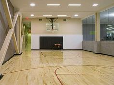 Indoor Basketball court in the basement.dream home, maybe a soccer field instead. That would be bad ass! Home Basketball Court, Basketball Room, Sports Court, Soccer, Dream House Plans, My Dream Home, Gym Decor, Luxury Homes Dream Houses, Interior Stairs