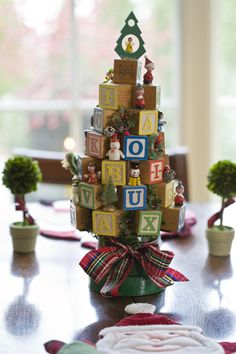 Creative Centerpiece idea!-Mini Christmas Tree made from children's wood blocks and vintage mini ornaments.