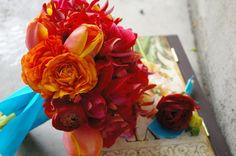 orange and red wedding flowers | centerpiece idea for your wedding blue purple and red and