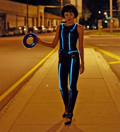Do you want your Tron costume to glow like this one, created by designer Syuzi? Then you need to learn about electroluminescent wire. There's a great tutorial over on Adafruit that teaches you everything you need for Tron cosplay.