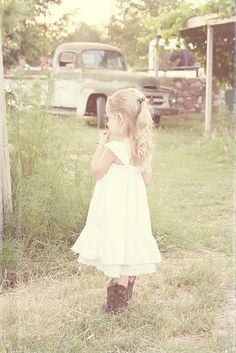 lovely little whit dress and cowboy boots