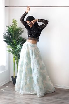 Who said florals can only be worn in the summer ? Our floral skirts can be paired with multiple styles of tops to create stunning outfits that can be worn all year round. Indian Fashion Dresses, Indian Gowns Dresses, Dress Indian Style, Indian Designer Outfits, Designer Dresses, Pakistani Dresses, Indian Wedding Outfits, Bridal Outfits, Indian Outfits