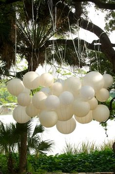 Love the clustered lantern look.  If you dropped some ribbons down, would look like jelly fish!