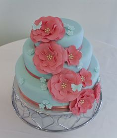 Duck egg blue and coral wedding cake