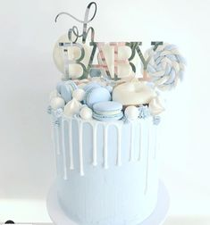 15 Gorgeous Boy Baby Shower Cakes - Find Your Cake Inspiration Have a baby boy on way or want to plan a baby boy shower? Check out unique baby boy shower cake ideas ranging from simple buttercream to fondant designs. Torta Baby Shower, Baby Shower Drip Cake, Tortas Baby Shower Niña, Baby Shower Pasta, Deco Baby Shower, Baby Shower Cakes For Boys, Baby Shower Parties, Baby Boy Shower, Baby Shower Cake Toppers