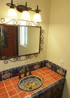 Bathroom vanity using Mexican tiles by kristiblackdesigns.com