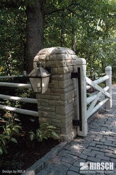 Really cool entry to house......Lannon stone entry pillar with custom curved top