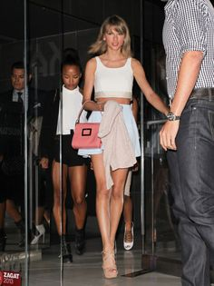 Taylor Swift leaving Katsuya restaurant in Hollywood with Serayah. See all of the singer's best looks.