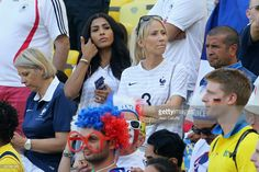 Mazda Magui Sakho, wife of Mamadou Sakho of France, and Sandra Evra, wife of Patrice Evra of France, attend the 2014 FIFA World Cup Brazil Quarter Final match between France and Germany at Maracana on July 4, 2014 in Rio de Janeiro, Brazil.