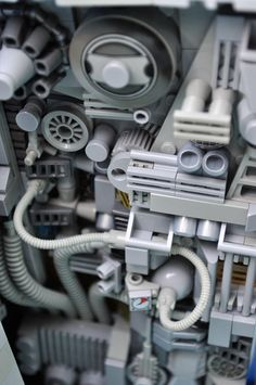 LEGO wall of engine parts and components. Tubes, wires, dials, vents, turbines, hoses, exhausts, gears, and pistons.