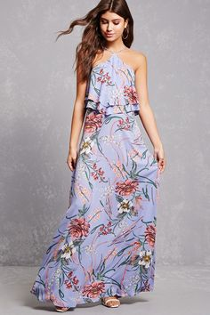5d998f31ea7 A woven sleeveless maxi dress featuring an allover floral print
