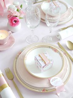A touch of gold adds luxury and helps elevate the ensemble of more casual pieces on display. The hint of shimmer is carried through the tableware, flatware and napkin rings, which were made by wrapping gold crepe paper and pink satin ribbon around a crisp white linen napkin.