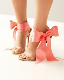 have bridesmaids wear neutral shoes with an ankle strap then just tie on ribbon bows in your colour! easy and fun.