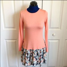 "Pink and Floral Dress Super soft and light with stretch. Top with skirt look but all connected. Top fitted and skirt piece is loose. Could also be worn as a tunic. Peachy-pink color. 95% rayon, 5% spandex. Bust 35"" (not stretched), length shoulder to hem 34"". No trades. Price firm unless bundled. Dresses"
