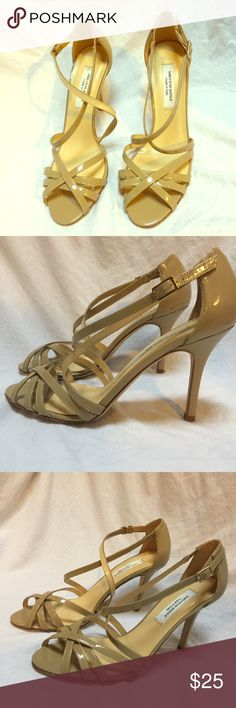 Saks Fifth Avenue Nude/Beige High Heeled Sandals Beautiful dressy heels!  A perfect match for any outfit!  Patent leather straps in s gorgeous nude/tan color.  Always in style! Saks Fifth Avenue Shoes Heels
