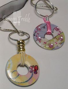 Washer Pendant Necklaces & Keychains   Haley Dyer shared some awesome Washer Pendant Necklaces, and also made a Tutorial on how she made them....you can find her Tutorial HERE! Thanks so much Haley for sharing! I did one thing different than Haley's instructions...I cut my circles a little bigger than my washers, spread the glue, let them dry, and then trimmed them. It was easier than trying to fit the cut circle onto the washer with glue-y fingers. I trimmed the outside edge with sciss