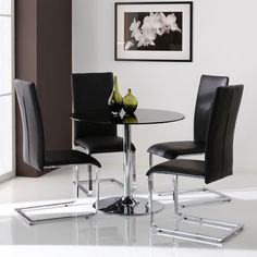 Orbit Round Dining Table  BlackModern Rectangular Solid Glass Dining Table with Black Chairs and  . Dining Table Black Glass. Home Design Ideas