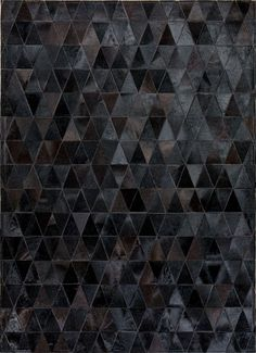 A Beautiful example from our solid colour collection. Displaying black in a way you have never seen before, each triangle patch geometrically stacked, glistening in the light providing the beauty of a dark story. Onyx evokes a strong, sophisticated feel but provides the centrepiece worth talking about.    https://mosaichides.com/patchworkrugs/pattern/pure/onix-405.html
