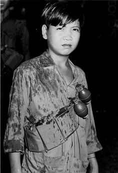 20 Nov 1969, Da Nang, Vietnam -- This battle-hardened 14-year-old boy recently served as a sniper for the Viet Cong. Now he fights for South Vietnam. ~ Vietnam War