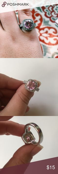 Pink Cushion Cut Diamond Fashion Ring Diamonds are a girl's best friend! Especially pink ones! This fun, fashion ring (not a real diamond) fits like a 7. Cushion cut style stone with rhinestones around pink stone and on sides of ring. Gently used with some normal surface scratches. Jewelry Rings