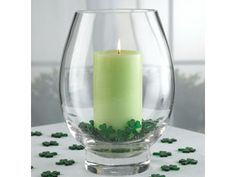 "What an easy way to decorate for different holidays. Just chang out the candle color and little ""chips"" to match the time of year. Shamrocks, pumpkins, snowflakes, etc..."