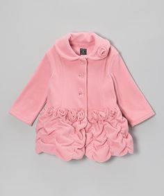 As timeless as it is time-saving, this stylish coat is made from warm, washable fleece with dainty rosette accents and a ruched drop-waist silhouette that resembles a princess's ball gown.100% polyesterMachine wash; tumble dryImported
