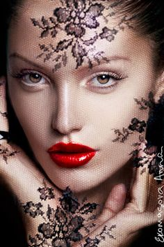 Black laced veil and red lips... stunning!