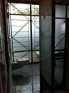 heated floor under glass tile, all glass and steel bathroom