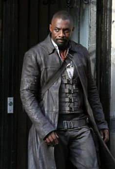 Actor Idris Elba plays a gunslinger for his upcoming movie project 'The Dark Tower' filming in Midtown Manhattan in New York City, New York on July 1, 2016. He wore a dark jacket and pants with a gun and shells on his belt.