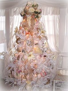 Whoa   I have to admit I love the gaudy yet beautiful shabby chic Christmas tree