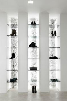 Elle Luxury shop, Italy by Leonardo Scarselli Architects White brick backlit shoe display