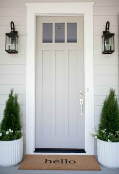 grey exterior house colors Come see why Sherwin Williams Dorian Gray is one of my favorite gray paint colors for just about any space in your home! A true, warm, gray paint. Painted Exterior Doors, Exterior Gray Paint, Exterior Paint Colors For House, Painted Front Doors, Paint Colors For Home, Gray Exterior Houses, Outside House Paint Colors, Exterior House Lights, Gray Houses