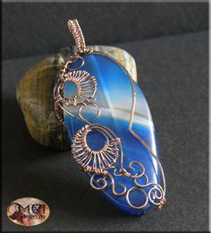 Water- handmade, wire wrapped pendant, blue agate, copper. £12.00, via Etsy.
