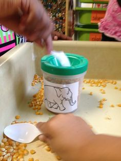 "Preschool fine motor practice- ""feeding"" animals using paint cups and popcorn kernels.  #preschool -age children can do this while older siblings do Apologia Land Animals #homeschool"