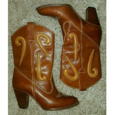 "COWBOY BOOTS The cutest vintage western boots! Cognac and tan rawhide leather, almond shaped toe with decorative stitching, wood stacked heel. Pull-on. Made in Brazil. 10"" heel to toe, 10"" shaft, 3"" heel, 14"" calf circumference. Vintage Shoes Heeled Boots"